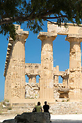 Tourists sightseeing at the ruins of ancient temples at Selinunte in Sicily, Italy - the largest archeological park in Europe.