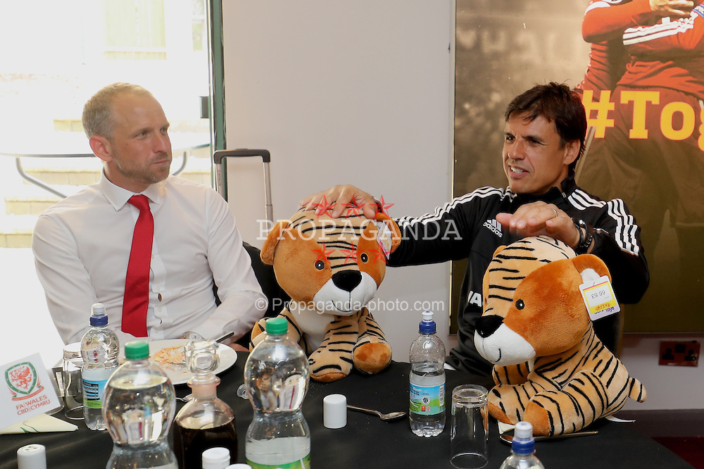 CARDIFF, WALES - Saturday, June 4, 2016: Wales' manager Chris Coleman with two cuddly toy tigers at the Vale Resort Hotel ahead of the International Friendly match against Sweden. (Pic by David Rawcliffe/Propaganda)