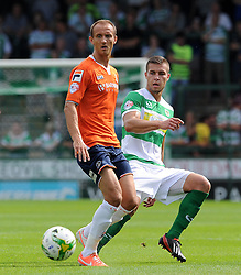 Jakub Sokalik of Yeovil Town is tackled by Paul Benson of Luton Town - Photo mandatory by-line: Harry Trump/JMP - Mobile: 07966 386802 - 22/08/15 - SPORT - FOOTBALL - Sky Bet League Two - Yeovil Town v Luton Town - Huish Park, Yeovil, England.