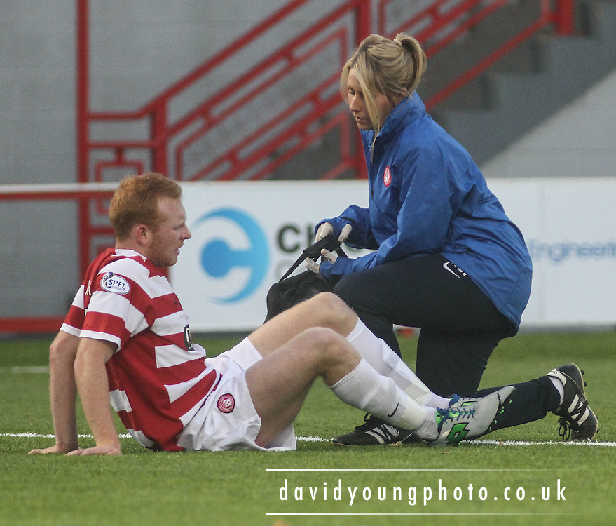 Hamilton's Ziggy Gordon gets treatment - Hamilton Academical v Dundee, SPFL Championship at New Douglas Park<br /> <br />  - &copy; David Young - www.davidyoungphoto.co.uk - email: davidyoungphoto@gmail.com