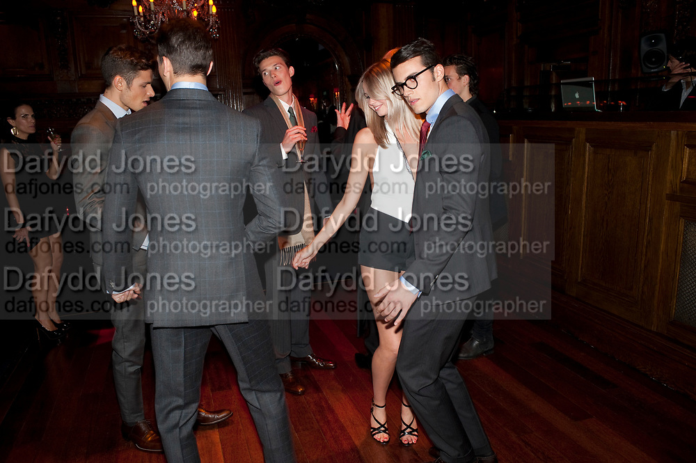GIRL DANCING) WITH MEN IN SUITS,  DSquared2 Launch of their Classic collection. Tramp. Jermyn St. London. 29 June 2011. <br /> <br />  , -DO NOT ARCHIVE-© Copyright Photograph by Dafydd Jones. 248 Clapham Rd. London SW9 0PZ. Tel 0207 820 0771. www.dafjones.com.