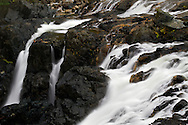 Detail of water flowing over the Upper Englishman River Falls in Englishman River Falls Provincial Park near Nanaimo, British Columbia, Canada