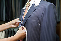 Tailor Fitting Man in Suit