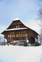 A traditional, old wooden house in the snow on the Lindenberg, Switzerland.