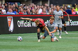 October 21, 2018 - Atlanta, GA, U.S. - ATLANTA, GA - OCTOBER 21: Atlanta United defender Julian Gressel (24) is dragged down by Chicago Fire midfielder Djordje Mihailovic (14) during the MLS game between the Atlanta United and the Chicago Fire on October 21, 2018 at the Mercedes-Benz Stadium in Atlanta, GA. Atlanta United FC secured a place in next year's CONCACAF Champions League with a 2-1 victory against the visiting Chicago Fire. (Photo by John Adams/Icon Sportswire) (Credit Image: © John Adams/Icon SMI via ZUMA Press)