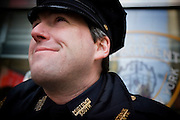 20th January 2009, the inauguration of President Obama..Time stands still as Americans unite at Time Square, New York City, to watch the jumbotrons with hope and joy as the 1st African-American President of USA takes the oath to lead the country through difficult times.  An NYPD policeman cries during an emotional speech by President Barack Obama...Image © Arsineh Houspian/Falcon Photo Agency