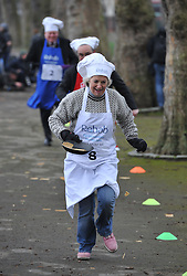 Tessa Munt MP takes part in the MP's and Lords race against political Journalist in the Rehab Parliamentary Pancake Shrove Tuesday race a charity event which sees MPs and Lords joined by media types in a race to the finish. Victoria Tower Gardens, Westminster, Tuesday February 12, 2013. Photo By Andrew Parsons / i-Images