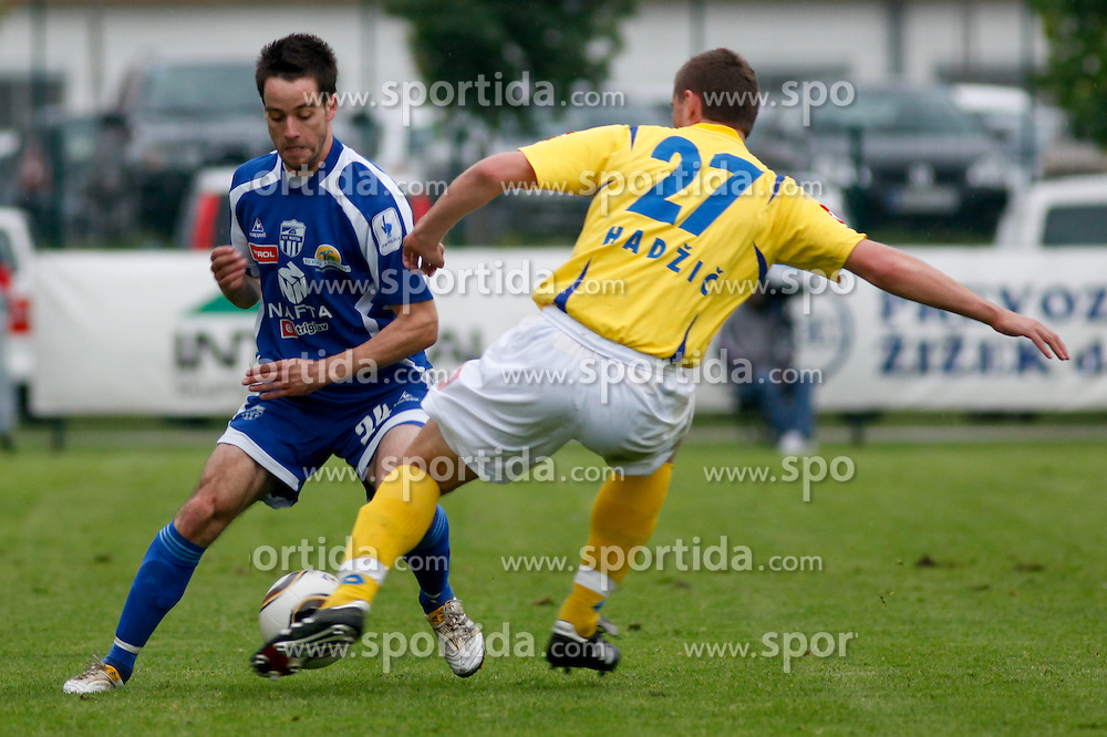 Rok Buzeti of Nafta vs Damir Hadzic of Koper at the football match between NK Nafta Lendava and NK Luka Koper of PrvaLiga league on May 16, 2010 in Lendava, Slovenia. Nafta lost 1 : 2, Koper became National champion.  (Photo by Urban Urbanc / Sportida)