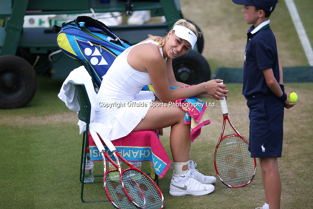 July 01 2014 Day  Eight: The Championships - Wimbledon 2014 <br /> Sabine Lisicki celebrates victory over Shvedova, taking a rest on the chair.<br /> Photo: Mark Leech
