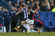Brentford midfielder Alan Judge tackles Sheffield Wednesday striker Fernando Forestieri  during the Sky Bet Championship match between Sheffield Wednesday and Brentford at Hillsborough, Sheffield, England on 13 February 2016. Photo by Simon Davies.