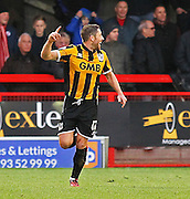 Port Vale's Michael Brown celebrates the opening goal during the Sky Bet League 1 match between Crawley Town and Port Vale at Broadfield Stadium, Crawley, England on 20 December 2014. Photo by Phil Duncan.