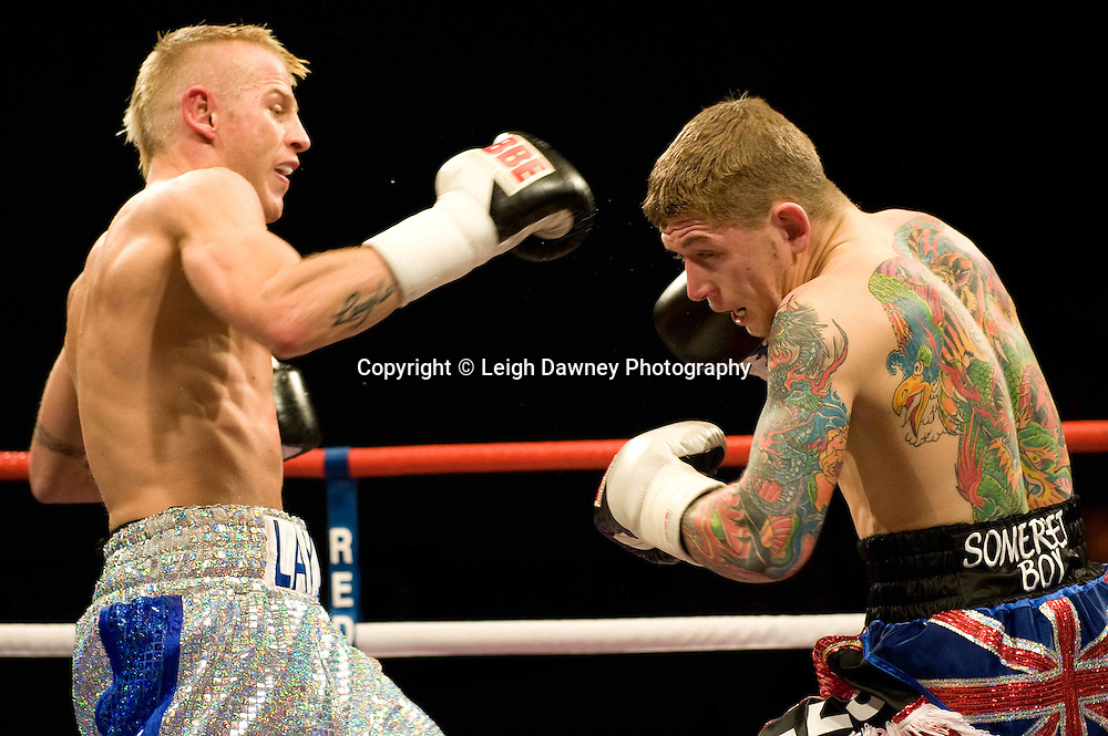 Gary Sykes defeats Dean Mills (red shorts) at the Harvey Hadden Leisure Centre 5th February 2010 Frank Maloney Promotions . Photo credit © Leigh Dawney
