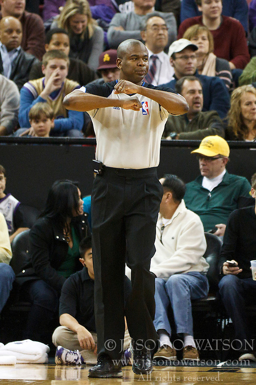 January 19, 2011; Sacramento, CA, USA;  NBA referee Sean Wright (65) calls a traveling penalty during the second quarter between the Sacramento Kings and the Portland Trail Blazers at the ARCO Arena. Portland defeated Sacramento 94-90 in overtime.