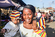 smiling woman with two children at a Food market in Madagascar