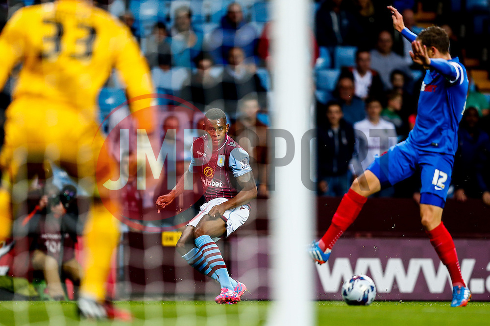 Leandro Bacuna of Aston Villa crosses the ball in past Shane Lowry of Leyton Orient - Photo mandatory by-line: Rogan Thomson/JMP - 07966 386802 - 27/08/2014 - SPORT - FOOTBALL - Villa Park, Birmingham - Aston Villa v Leyton Orient - Capital One Cup Round 2.