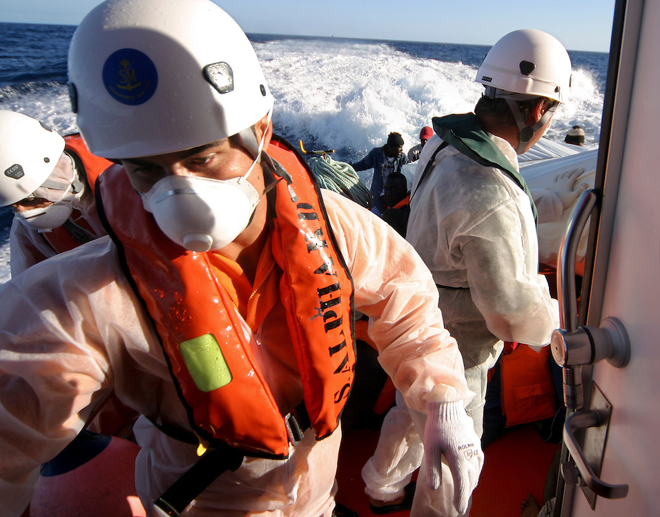 Coastguard members are seen during a rescue mission. The cayuco was intercepted 80 miles away from the coast of Tenerife, in the Canary Islands, Spain, Wednesday, Oct. 24, 2007.