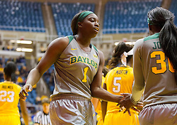 Jan 30, 2016; Morgantown, WV, USA; Baylor Bears forward Dekeiya Cohen (1) celebrates with guard Alexis Jones (30) after a foul during the second quarter against the West Virginia Mountaineers at WVU Coliseum. Mandatory Credit: Ben Queen-USA TODAY Sports