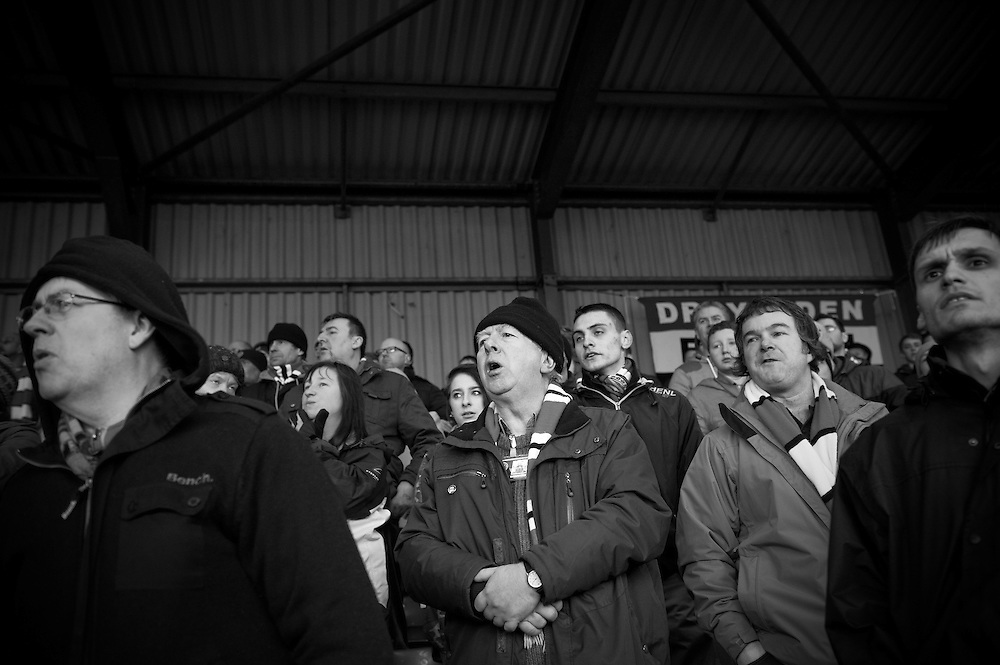 FC United of Manchester play a local team Chorley at Bury football club's ground in Lancashire, Britain. Photo shows FC United of Manchester supporters on the terraces during the match.