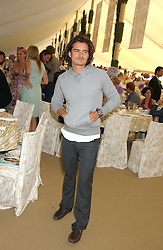 Actor ORLANDO BLOOM at the 2005 Cartier International Polo between England & Australia held at Guards Polo Club, Smith's Lawn, Windsor Great Park, Berkshire on 24th July 2005.<br />