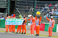 Marshals and fans of Charlie Whiting (GBR) FIA Delegate.<br /> Japanese Grand Prix, Saturday 4th October 2014. Suzuka, Japan.