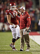 Nov 12, 2011; Fayetteville, AR, USA;  Arkansas Razorbacks head coach Bobby Petrino talks with center Travis Swanson (64) during a game against the Tennessee Volunteers at Donald W. Reynolds Razorback Stadium. Arkansas defeated Tennessee 49-7. Mandatory Credit: Beth Hall-US PRESSWIRE