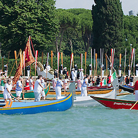 VENICE, ITALY - JUNE 05:Rowers from several associations lift the oars to salute the Navy cadets during the procession in Bacino St Mark on June 5, 2011 in Venice, Italy. The festival  of la Sensa is held in May the Sunday after Ascension Day  following the traditional ceremony where the doge enacted the wedding of Venice to the sea. The ritual has recently been revived,
