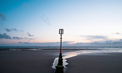 © Licensed to London News Pictures. 26/03/2014<br /> <br /> Redcar, Cleveland, United Kingdom<br /> <br /> A line of Groyne's can be seen at first light during low tide on the beach at Redcar, Cleveland.<br /> <br /> Photo credit : Ian Forsyth/LNP