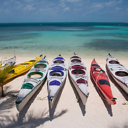 Kayaks on beach at South Water Caye, Belize