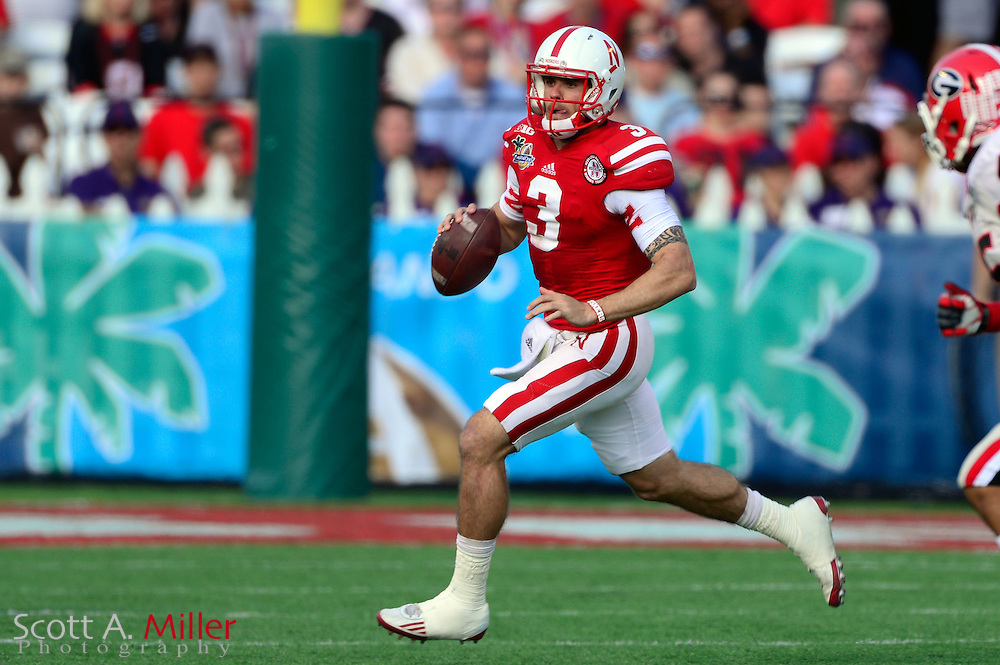Nebraska Cornhuskers quarterback Taylor Martinez (3) runs upfield during the Georgia Bulldogs 45-31 win over the Cornhuskers in the Capital One Bowl at the Florida Citrus Bowl on Jan 1, 2013 in Orlando, Florida. ..©2012 Scott A. Miller..