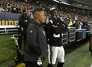 Aug 22, 2019; Winnipeg, Manitoba, CAN; Oakland Raiders wide receiver Antonio Brown (84) talks with Marcus Padilla in the second half against the Green Bay Packers at Investors Group Field. The Raiders defeated the Packers 22-21.