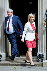 © Licensed to London News Pictures. 09/06/2015. Westminster, UK. Transport Secretary PATRICK MCLOUGHLIN and Environment, Food and Rural Affairs Secretary LIZ TRUSS attending to a cabinet meeting in Downing Street on Tuesday, 9 June 2015. Photo credit: Tolga Akmen/LNP