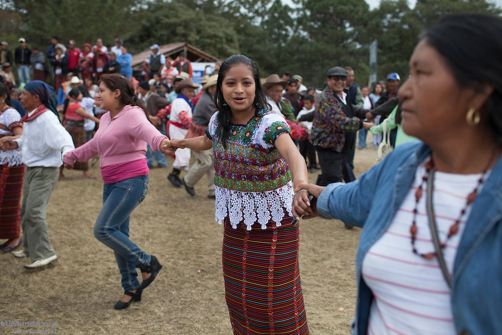 "People dance during a Western People's Council (Consejo de Pueblos del Occidente - CPO -, in Spanish) political event in the ancient Mayan site of Zaculeu on the last day of the Mayan Era known as 13 Baktun. The CPO, which held a political event to counteract the official State-run celebrations, claim ""it is offensive for the Maya people to see the economic power and government institutions promote the folklorization of Oxlajuj B'ak'tun, commodifying this important event, creating a political image out of tourist promotion and the presentation of spectacles, in a way that does not appropriately interpret the Maya cosmovision"" . Zaculeu, Huehuetenango, Guatemala. December 21, 2012."
