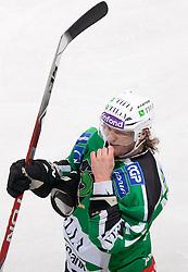 Tomi Mustonen of Olimpija during ice-hockey match between HDD Tilia Olimpija and HK Acroni Jesenice in 26th Round of EBEL league, on December 10, 2010 at Hala Tivoli, Ljubljana, Slovenia.(Photo By Vid Ponikvar / Sportida.com)