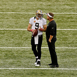 Oct 5, 2014; New Orleans, LA, USA; New Orleans Saints quarterback Drew Brees (9) talks with head coach Sean Payton prior to kickoff of a game against the Tampa Bay Buccaneers at Mercedes-Benz Superdome. Mandatory Credit: Derick E. Hingle-USA TODAY Sports