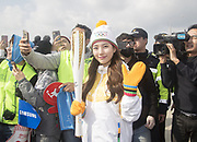 Suzy (miss A), Nov 1, 2017 : South Korean actress and singer from girl group miss A, Suzy, who is a torch bearer, attends the Olympic Torch Relay on the Incheon Bridge in Incheon, west of Seoul, South Korea. The Olympic flame arrived in Incheon, South Korea on Wednesday and it is going to be passed across the country during a 100-day tour until the opening ceremony of the 2018 PyeongChang Winter Olympics which will be held for 17 days from February 9 - 25, 2018.  Photo by Lee Jae-Won (SOUTH KOREA) www.leejaewonpix.com