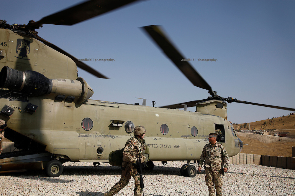 German personnel dimount from a US Chinook helicopter at german OP North, Northern Afghanistan