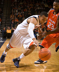 Virginia guard Calvin Baker (4) struggles to get past Auburn guard Quantez Robertson (23).  The Auburn Tigers defeated the Virginia Cavaliers 58-56 at the University of Virginia's John Paul Jones Arena  in Charlottesville, VA on December 20, 2008.  (Special to the Daily Progress / Jason O. Watson)