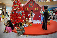 Customers at Christmas decoration at shopping mall in Yangon, Myanmar on December 15, 2015. (Photo by Kuni Takahashi)