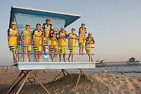26 September 2011: 2011 Little League Baseball World Series Championship team portrait northside of the Huntington Beach Pier at sunset in Southern California.  Ocean View team WEST beat Hamamtsu City, Japan, 2-1, to become the seventh team from California to win the title on August 28, 2011 in South Williamsport, PA. In Photo: Furry, Takada, Windisch, Cianca, Kotkosky, Mayorga, Palmer, Anderson, Catano.