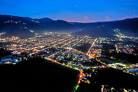 Aerial view of Antigua, Guatemala and nearby towns at sunset with street lights on, taken on Tuesday, Sept. 18, 2018.