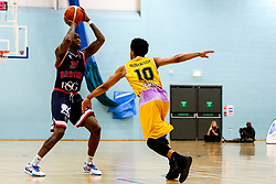Fred Thomas of Bristol Flyers takes on Justin Robinson of London Lions - Photo mandatory by-line: Robbie Stephenson/JMP - 10/04/2019 - BASKETBALL - UEL Sports Dock - London, England - London Lions v Bristol Flyers - British Basketball League Championship
