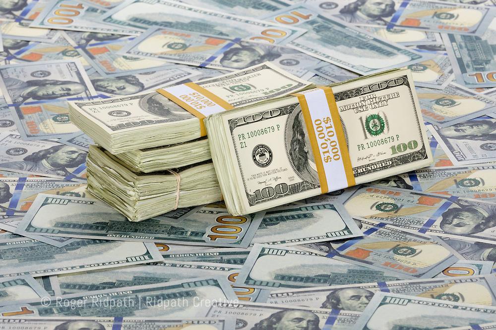 American $100 bills paper money Benjamin Franklin stacks