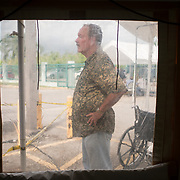 OCTOBER 24 - PONCE, PUERTO RICO - <br /> Retired doctor Miguel Busquets, 71, as seen through a plastic window from a temporary hospital tent set up outside the Ponce VA hospital.<br /> (Photo by Angel Valentin/Freelance)
