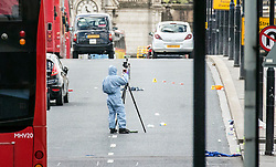 © Licensed to London News Pictures. 04/06/2017. London, UK. Forensics officers working on London Bridge where seven people are reported to have been killed after a white van veered off the road and hit a number of pedestrians. Police are treating the incident as an act of terrorism. Photo credit: Rob Pinney/LNP
