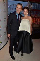 RAYNALD AESCHLIMANN and ANNA FRIEL at the OMEGA 100 days to Rio Olympics VIP Dinner at Sushi Samba, Heron Tower, 110 Bishopsgate, City of London on 27th April 2016.