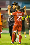 Gabriele Cioffi, Head Coach of Crawley Town FC celebrates the win for Crawley with Dannie Bulman (Capt) (Crawley Town) following the EFL Cup match between Crawley Town and Norwich City at The People's Pension Stadium, Crawley, England on 27 August 2019.