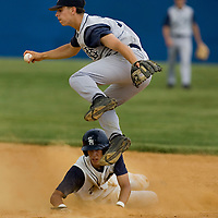 (SPORTS) Toms River 6/11/2005  CBA's #17 Pete Delleani leaps over the slide of Seton Hall Preps # 21 Rick Porcello during a play at second base.  Michael J. Treola Staff Photographer.....MJT