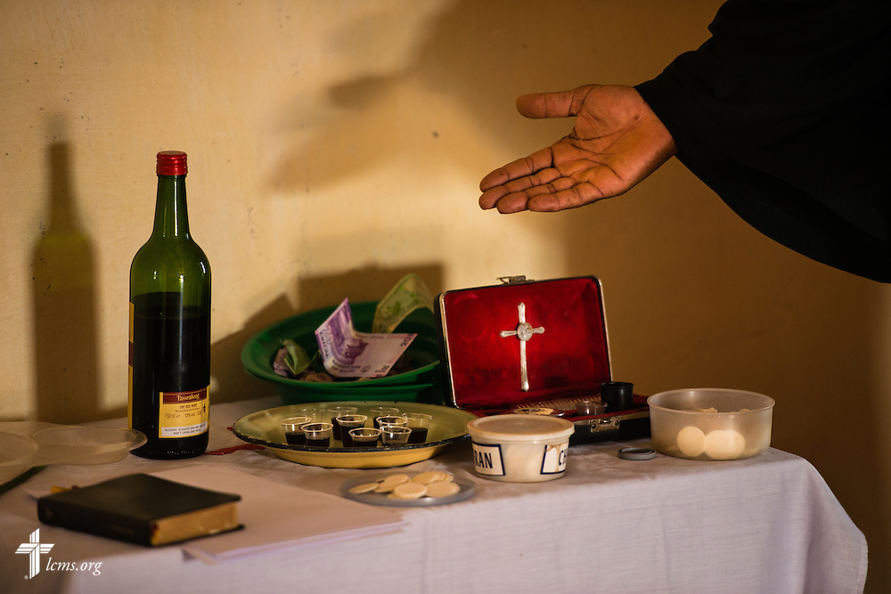 The Rev. Davis Wowa, executive chairman of the Confessional Lutheran Church–Malawi Synod, prepares to distribute the sacrament during worship in a parish on Saturday, Sept. 26, in Embangweni, Malawi. LCMS Communications/Erik M. Lunsford