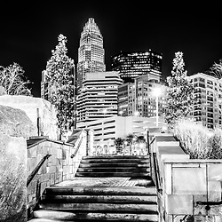 Charlotte at night black and white photo with Romare Bearden Park stairs, Bank of America Corporate Center, and other downtown Charlotte city buildings. Charlotte is a major city in North Carolina in the Eastern United States of America.