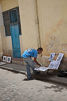 A local artist sells his sketches on the streets of Old Havana, Cuba.